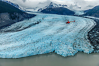Pollux aviation helicopter flies over Inner Lake George and Colony Glacier.  Alaska.  Summer. <br /> <br /> Photo by Jeff Schultz/SchultzPhoto.com  (C) 2018  ALL RIGHTS RESERVED<br /> Amazing Views-- Into the wild photo tour 2018