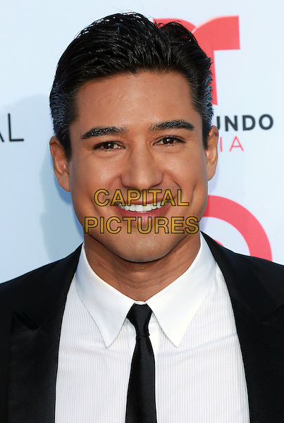 Mario Lopez<br /> 2013 NCLR ALMA Awards held at Pasadena Civic Auditorium, Pasadena, California, USA, 27th September 2013.<br /> portrait headshot white shirt black suit tie smiling <br /> CAP/ADM/KB<br /> &copy;Kevan Brooks/AdMedia/Capital Pictures