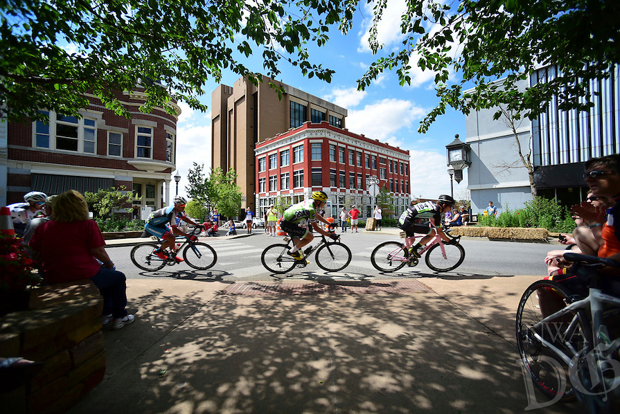 NWA Democrat Gazette/SPENCER TIREY Riders in men's pro category take a turn through the Fayetteville square, Sunday, April 24, 2016, during the criterium stage of the Joe Martin Stage Race.