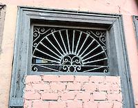Peru, Lima.  Old Metal Grill in Window.