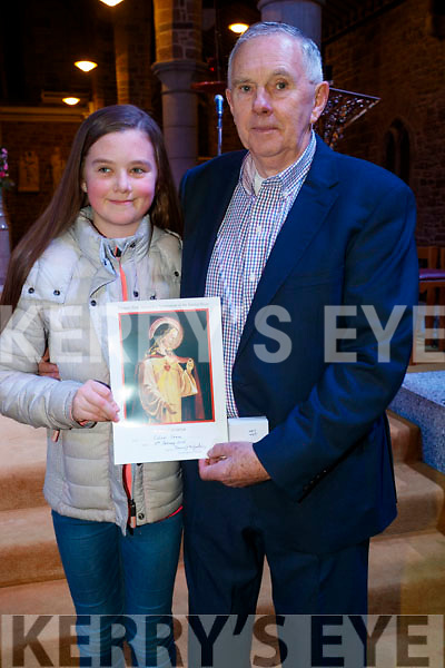 Colm Keane (55 years pioneer) pictured with his granddaughter Sarah Maunsell, who received her pioneer pin at St. John Church, Tralee on Sunday last.