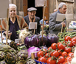 People shopping at produce market. Sicily, Italy