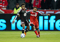 16 April 2011: D.C. United midfielder Clyde Simms #19 and Toronto FC forward Javier Martina #33 in action during an MLS game between D.C. United and the Toronto FC at BMO Field in Toronto, Ontario Canada..D.C. United won 3-0.
