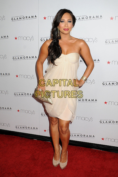 Cheryl Burke.Macy's Passport Presents Glamorama 2012 at the Orpheum Theatre, Los Angeles, California, USA, .7th September 2012..full length strapless beige cream dress bustier side ponytail hair hand on hip gold cuff clutch bag shoes nude .CSP/ADM/BP.©Byron Purvis/AdMedia/Capital Pictures..