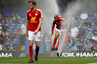 David McGoldrick of Sheffield United jumps over sprinklers during the Premier League match between Chelsea and Sheff United at Stamford Bridge, London, England on 31 August 2019. Photo by Carlton Myrie / PRiME Media Images.