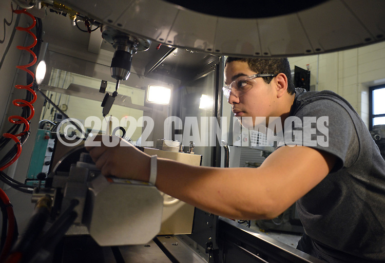 FAIRLESS HILLS, PA - NOVEMBER 5: Marcello Scacciotti, of Bristol, Pennsylvania works on a machine in Machine Technology at Bucks County Technical High School November 5, 2014 in Fairless Hills, Pennsylvania.  (Photo by William Thomas Cain/Cain Images)