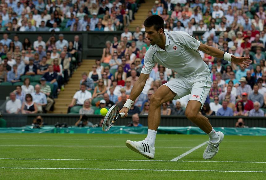 Novak Djokovic SRB (1) in action today during his victory over Radek Stepanek CZE in their Gentlemen's Singles Third Round match - Novak Djokovic SRB (1) def Radek Stepanek CZE (28) 4-6 6-2 6-2 6-2..Tennis - Wimbledon Lawn Tennis Championships - Day 5 - Friday 29th June 2012 -  All England Lawn Tennis Club - Wimbledon - London - England...