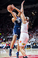 College Park, MD - DEC 29, 2016: Connecticut Huskies guard Gabby Williams (15) goes up strong to the basket against Maryland Terrapins center Brionna Jones (42) during game between No. 1 UConn and the No. 3 Terrapins at the XFINITY Center in College Park, MD. UConn defeated Maryland 87-81. (Photo by Phil Peters/Media Images International)