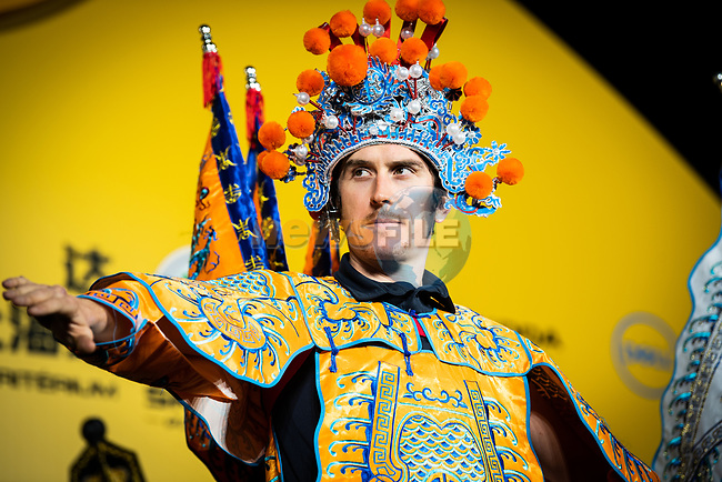 Yellow Jersey Geraint Thomas (WAL) wearing a Bejing Opera costume on stage at the media day before the 2018 Shanghai Criterium, Shanghai, China. 16th November 2018.<br /> Picture: ASO/Pauline Ballet | Cyclefile<br /> <br /> <br /> All photos usage must carry mandatory copyright credit (&copy; Cyclefile | ASO/Pauline Ballet)