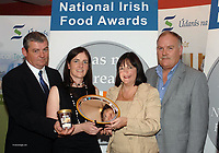 At the  Blas na hEireann  National Irish Food and Drink Awards at the Dingle Peninsula Food and Wine Festival in Benners Hotel Dingle were  from left,  Artie Clifford, Chairman Blas na hEireann, Maureen Clohessy, Supervalu, accepting the Blas na hEireann supreme champion prize on behalf of overall winner Silverpail- Supervalu Supreme truffle fudge ice cream, from  Mairead and Brian De Staic.  Picture: Eamonn Keogh (MacMonagle, Killarney) <br /> <br /> <br /> &copy; Photo by Don MacMonagle - macmonagle.com<br /> info@macmonagle.com