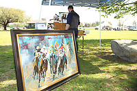 HOT SPRINGS, AR - MARCH 18: An artist painting horse racing scenery canvas' before the running of the Rebel Stakes at Oaklawn Park on March 18, 2017 in Hot Springs, Arkansas. (Photo by Justin Manning/Eclipse Sportswire/Getty Images)