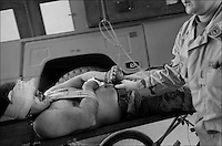 A nurse escorts a EOD technician wounded in the face by the IED at the hospital at Kandahar Airfield, Afghanistan, September 21, 2010.