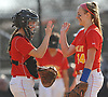 Battery mates Claire O'Brien #14, pitcher, right, and Kate Karamouzis #4, catcher, slap hands during a CHSAA varsity softball game against Kellenberg at Greis Park in Lynbrook on Tuesday, April 11, 2017. Sacred Heart won by run rule 9-0 after four and a half innings of play.