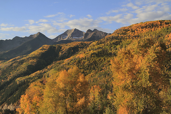 From McCLure Pass, with Capital Peak (14,130 ft) left, Snowmass Mountain (14,099 ft) right, Aspen trees, Colorado. John offers autumn photo tours throughout Colorado.