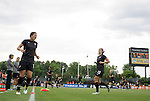 18 May 2011: Abby Wambach (left) (USA), Alex Morgan (13) (USA) and teammates (behind) warm up before the game. The United States Women's National Team defeated the Japan Women's National Team 2-0 at WakeMed Stadium in Cary, North Carolina as part of preparations for the 2011 Women's World Cup.