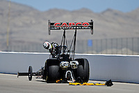 Mar. 31, 2012; Las Vegas, NV, USA: NHRA top fuel dragster driver Steve Torrence looks back at his engine after blowing an engine during qualifying for the Summitracing.com Nationals at The Strip in Las Vegas. Mandatory Credit: Mark J. Rebilas-US PRESSWIRE