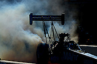 Jun. 29, 2012; Joliet, IL, USA: NHRA top fuel dragster driver Brandon Bernstein does a burnout during qualifying for the Route 66 Nationals at Route 66 Raceway. Mandatory Credit: Mark J. Rebilas-