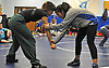 Lisauri Almanzar, a junior and varsity wrestler at Amityville High School, left, practices with Copiague seventh grader Stacey Rosado at Copiague High School on Tuesday, Jan. 31, 2017.
