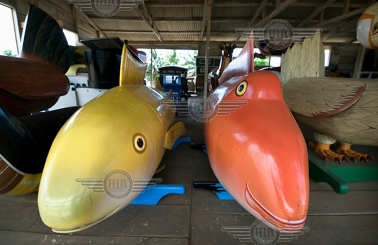Coffins constructed to resemble fish are displayed along with other unusually shaped coffins at a furniture workshop. In recent years it has become a custom in parts of Ghana to bury people in specially shaped coffins depicting the deceased person's profession, hobby or even cause of death.