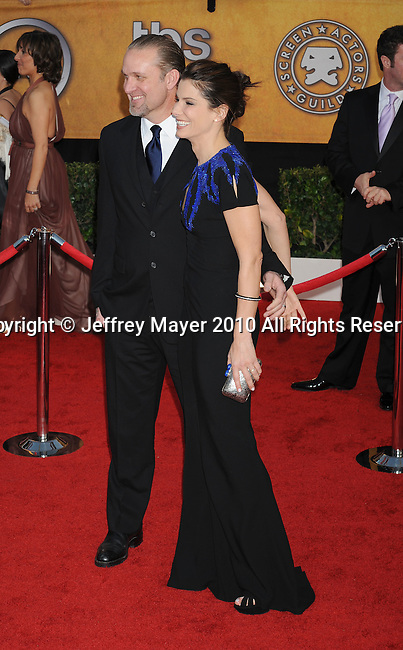 LOS ANGELES, CA. - January 23: Jesse James and actress Sandra Bullock arrive at the 16th Annual Screen Actors Guild Awards held at The Shrine Auditorium on January 23, 2010 in Los Angeles, California.