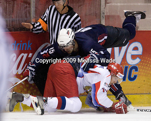 Chris Kreider (US - 15), Petr Khokhriakov (Russia - 14) - Team Russia defeated Team USA 6-4 in their third game in the 1980/Herb Brooks (international-size) Rink on Friday, August 14, 2009, during the 2009 USA Hockey National Junior Evaluation Camp in Lake Placid, New York.