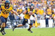 Landover, MD - SEPT 24, 2016: West Virginia Mountaineers quarterback Skyler Howard (3) rolls out the pocket during their match up against BYU at FedEx Field in Landover, MD. (Photo by Phil Peters/Media Images International)