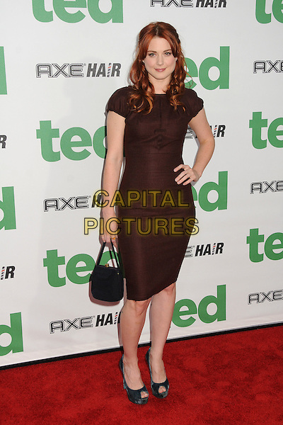 Alexandra Breckenridge.The L.A. Premiere of 'Ted' held at The Grauman's Chinese Theatre in Hollywood, California, USA..June 21st, 2012.full length dress hand on hip black handbag purse bag brown.CAP/ADM/BP.©Byron Purvis/AdMedia/Capital Pictures.