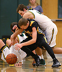 Manogue's Jack Mayer and Galena's Josiah Wood fight for a loose ball at Manogue High School in Reno, Nev., on Tuesday, Feb. 11, 2014. Manogue won 51-29.<br /> Photo by Cathleen Allison