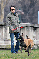 Anthony Delon, son of Alain Delon, plays with his dog in Paris - France