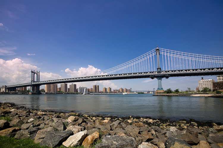 The Manhattan Bridge spans across the East River from Brooklyn to Manhattan.