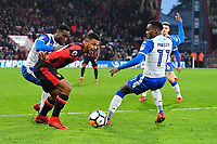 Lys Mousset of AFC Bournemouth goes past Gavin Massey of Wigan Athletic (r) during AFC Bournemouth vs Wigan Athletic, Emirates FA Cup Football at the Vitality Stadium on 6th January 2018