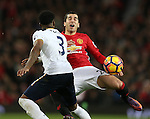Danny Rose of Tottenham tackles Henrikh Mkhitaryan of Manchester United during the English Premier League match at Old Trafford Stadium, Manchester. Picture date: December 11th, 2016. Pic Simon Bellis/Sportimage