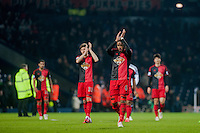 WEST BROMWICH, ENGLAND - FEBRUARY 11:  Ashley Williams of Swansea City    applauds the Swansea City fans  after the final whistle at  the Premier League match between West Bromwich Albion and Swansea City at The Hawthorns on February 11, 2015 in West Bromwich, England. (Photo by Athena Pictures/Getty Images)