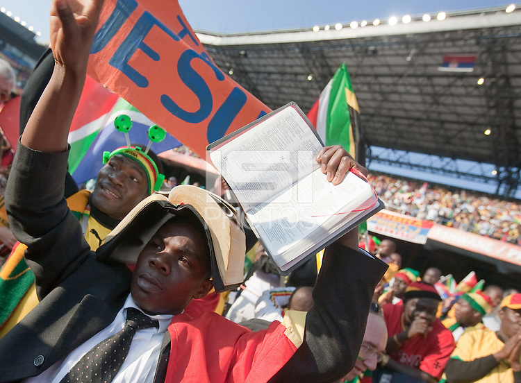 "Two Ghana fans hold up the bible and signs saying ""Believe in Jesus""   before the 2010 World Cup first round match between Serbia and Ghana at Loftus Versfeld Stadium in Pretoria, South Africa on Saturday, June 12, 2010."