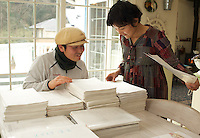 Japanese baker, Mizuki Taira, 36, and his wife Fusako,  in their home bakery called Gateau d'Ange, Kamakura, Japan 09 Feb 11, look at the eight year waiting list piled-up.  Mizuki Taira, turned to baking after a nasty bicycle accident, as part of his rehabilitation.