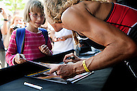 Chrissie Wellington signs autographs for her fans at Triathlon Park two days before the Challenge Roth Ironman Triathlon, Roth, Germany, 08 July 2011