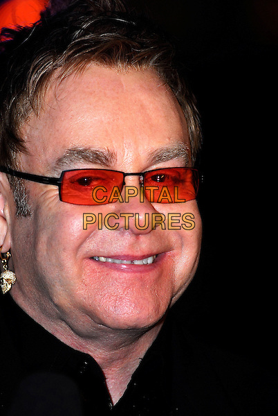 "ELTON JOHN .""It's A Boy Girl Thing"" World Charity Premiere, Odeon West End, London, UK..December 18th 2006.headshot portrait sunglasses shades.CAP/IA.©Ian Allis/Capital Pictures"