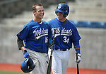 Western Nevada's Joey Crunkilton, left, celebrates at the plate with Sam Hall after hitting a home run in a college baseball game against Colorado Northwestern at John L. Harvey Field in Carson City, Nev., on Friday, April 11, 2014. <br />
