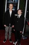 HOLLYWOOD, CA - MARCH 26: Evan Bird and Seth Isaac Johnson  arrive at AMC's 'The Killing' Season 2 Los Angeles Premiere at the ArcLight Cinemas on March 26, 2012 in Hollywood, California.
