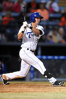 Asheville Tourists right fielder David Dahl #21 swings at a pitch during a game against the Delmarva Shorebirds at McCormick Field on April 4, 2014 in Asheville, North Carolina. The Shorebirds defeated the Tourists 7-2. (Tony Farlow/Four Seam Images)
