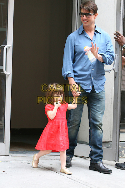 TOM CRUISE, SURI CRUISE .The Cruise family spotted in Greenwich Village, New York City, NY, USA, .August 15, 2008..full length father daughter blue shirt sunglasses child red dress bottle gold mary jane shoes bob jeans holding hands.CAP/LNC/DER.©LNC/Capital Pictures