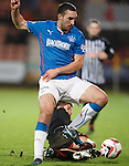 Lee Wallace wins the ball