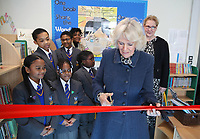 06 February 2019 - Camilla Duchess of Cornwall cuts the red ribbon as she opens the new library during a visit to St John's Angell Town Church of England Primary School  in London. Photo Credit: ALPR/AdMedia