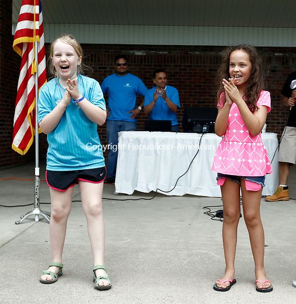 Waterbury, CT- 24 May 2014-052414CM03-   Sarah Rose, 8, of Waterbury, left, and Kara Jacques, 6, of Waterbury dance to the music of a DJ during a Memorial Day picnic at Library Park in Waterbury on Saturday. The event put on by the Wheeler Young VFW Post 201 was held to help pay for the construction of a Veterans of Foreign Wars post which will be located on Baldwin St. in Waterbury.     Christopher Massa Republican-American