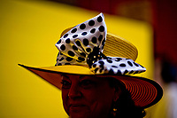 BALTIMORE, MD - MAY 20: A woman smiles as she walks through the grandstands before the start of racing on Preakness Stakes Day at Pimlico Race Course on May 20, 2017 in Baltimore, Maryland.(Photo by Scott Serio/Eclipse Sportswire/Getty Images)
