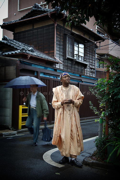 """Tokyo, October 26 2010 - Portrait of the beninese Rufin Zomahoun on the streets of Tokyo's Koenji neighbourhood, where he has been living for 14 years. Zomahoun is famous in Japan as a """"Gaijin Talento"""" (Foreign personality) after several TV shows, a book about Japan and for being a close friend of Takeshi Kitano."""