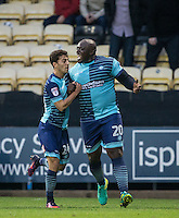 Adebayo Akinfenwa of Wycombe Wanderers celebrates his goal with Scott Kashket of Wycombe Wanderers during the Sky Bet League 2 match between Notts County and Wycombe Wanderers at Meadow Lane, Nottingham, England on 10 December 2016. Photo by Andy Rowland.
