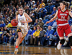 BROOKINGS, SD - FEBRUARY 4:  Kerri Young #10 from South Dakota State takes pushes the ball past Ciara Duffy #24 from the University of South Dakota during their game Saturday afternoon at Frost Arena in Brookings. (Photo by Dave Eggen/Inertia)