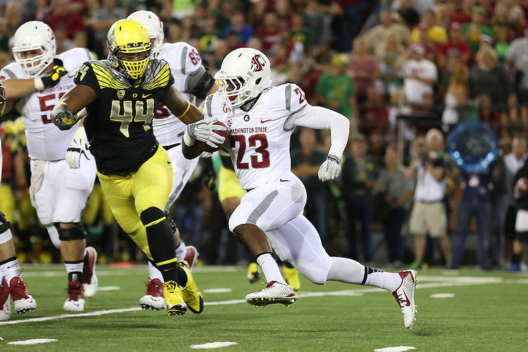 Gerard Wicks follows his blockers during the Washington State Cougars Pac-12 conference show down with the Oregon Ducks at Martin Stadium in Pullman, Washington, on September 20, 2014.  The Ducks defeated WSU 38-31, after a controversial obvious pass interference non-call on fourth down at the end of the game halted the Cougars drive to tie the game deep in Oregon territory.