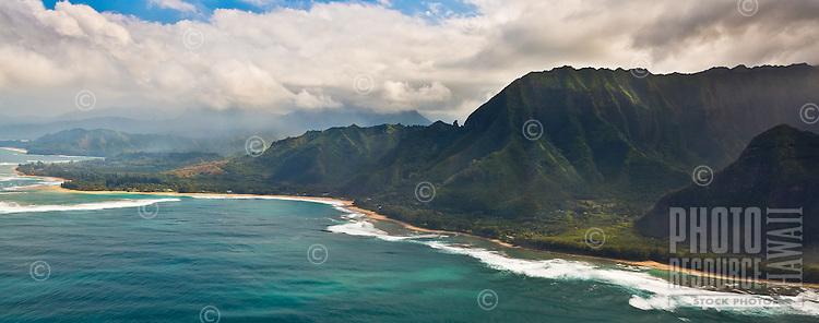 Na Pali Coast (or Napali Coast), northern Kaua'i, seen during a helicopter tour on a sunny day.